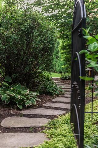 Take the private pathway through the garden.