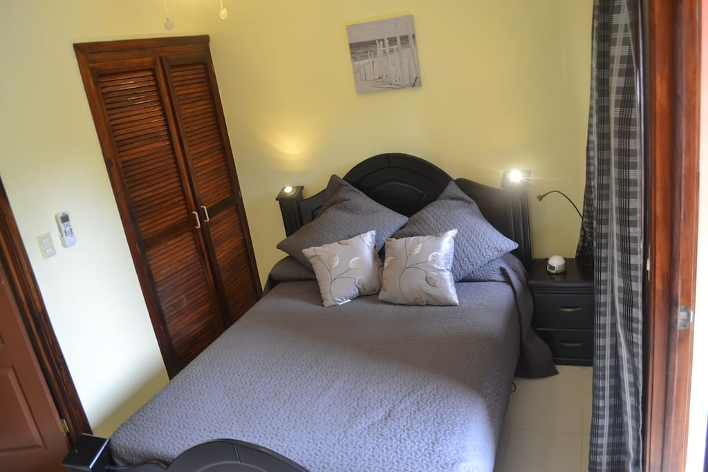This is the master bedroom, with balcony overlooking the pool and courtyard.  Has ensuite bathroom
