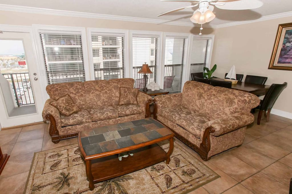Living room with sleep sofa and ceiling fan