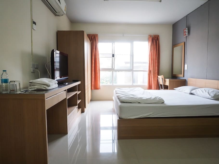 1 King size bed room with private bathroom and balcony ,dining table, TV, refrigerator, Free Wifi