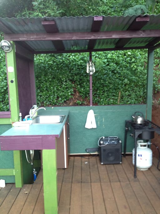 Out door kitchen. Ion music player.a gas stove and a mini fridge.  What more do u need?!
