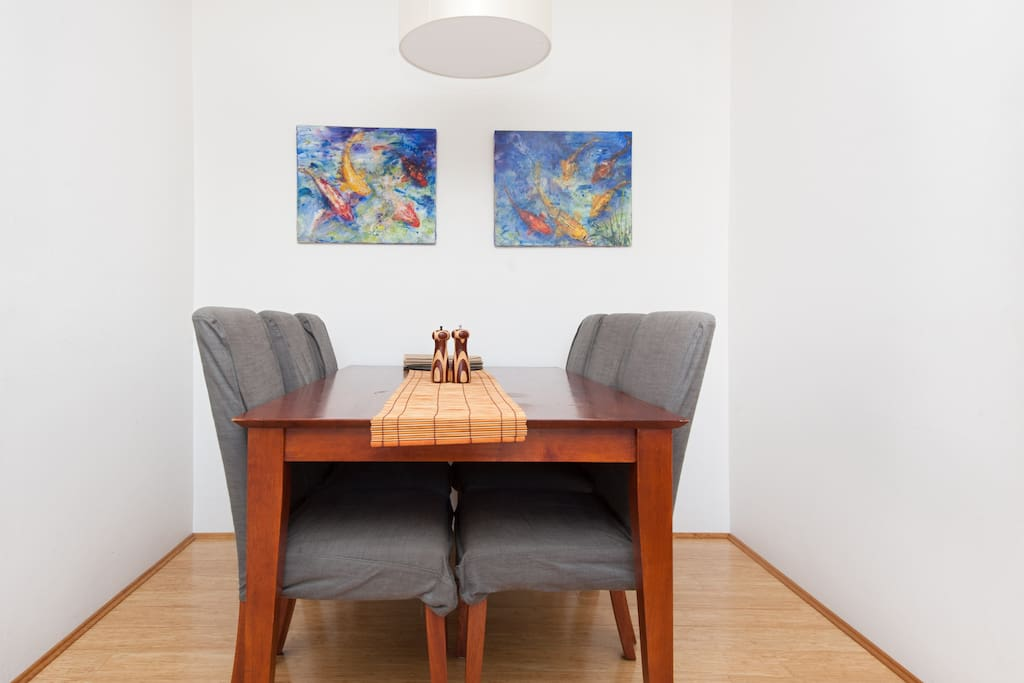 6 seater dining table in a beautiful art filled living room