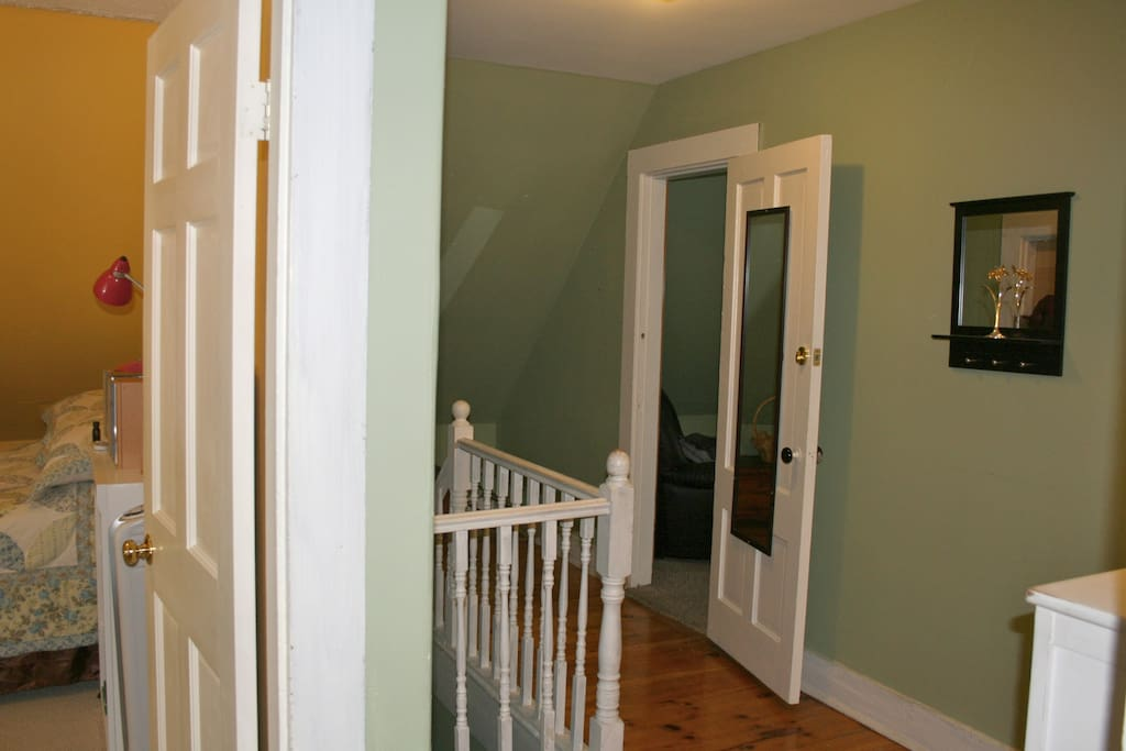 Guest bedrooms are separated by a hallway.
