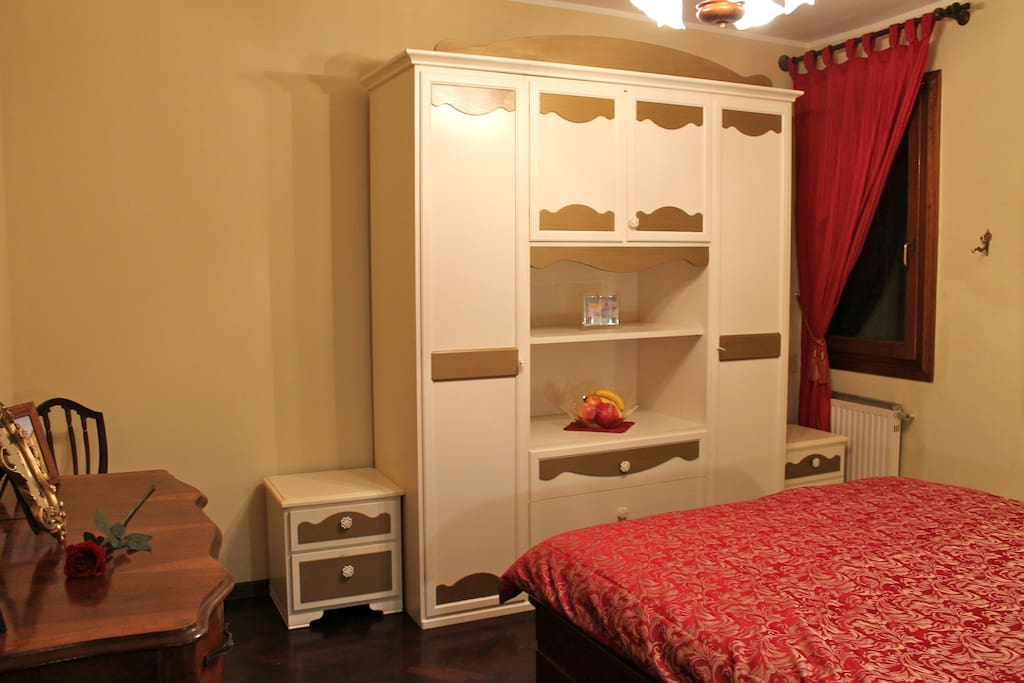 Master bedroom has plenty of storage.