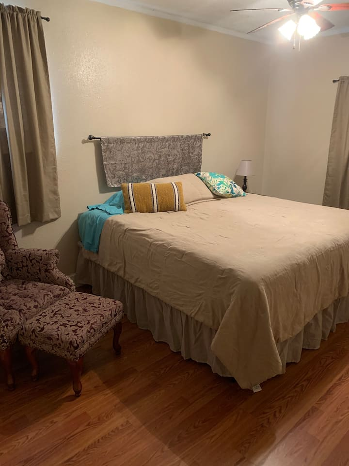 Large bedroom with king bed on a quiet street,