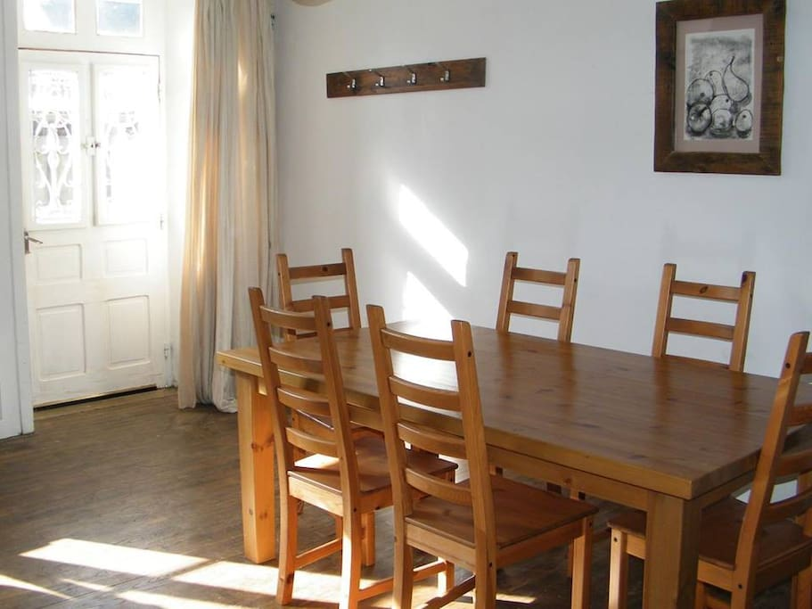 Dining area with seating for six (plus spare chairs for extra guests).