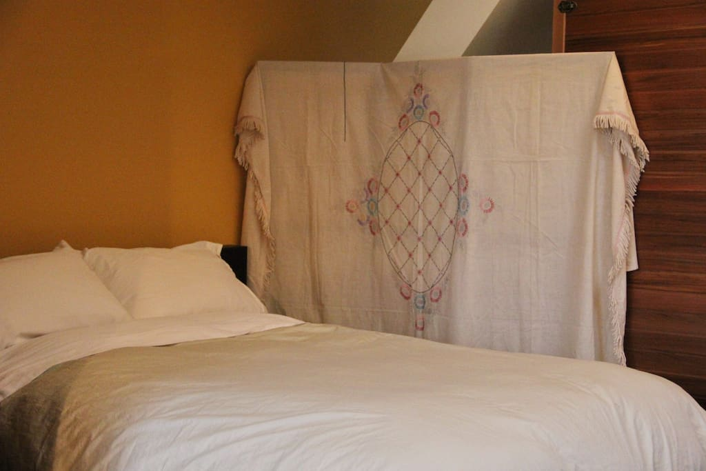 The screen is a hand embroidered bedspread from the thirties that was never finished.