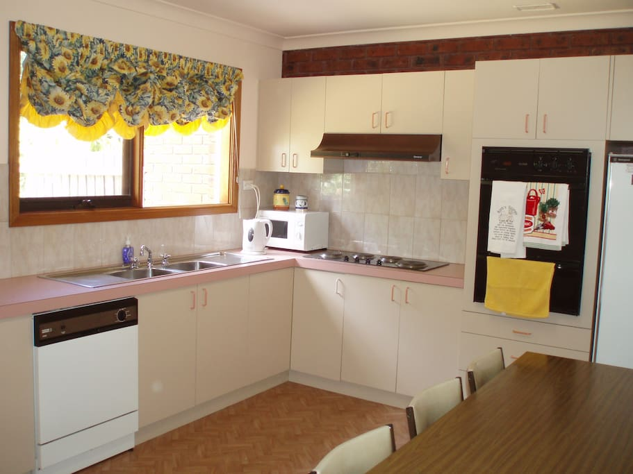 Well appointed kitchen with oven, microwave and dishwasher