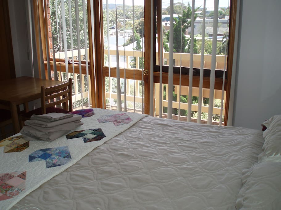 Master bedroom with queen bed. The other two bedrooms each have two King size single beds.