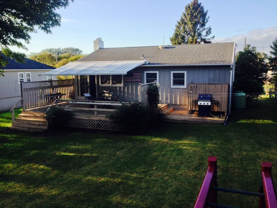 Rear view, patio deck with bbq, shower, retractable motorized awning