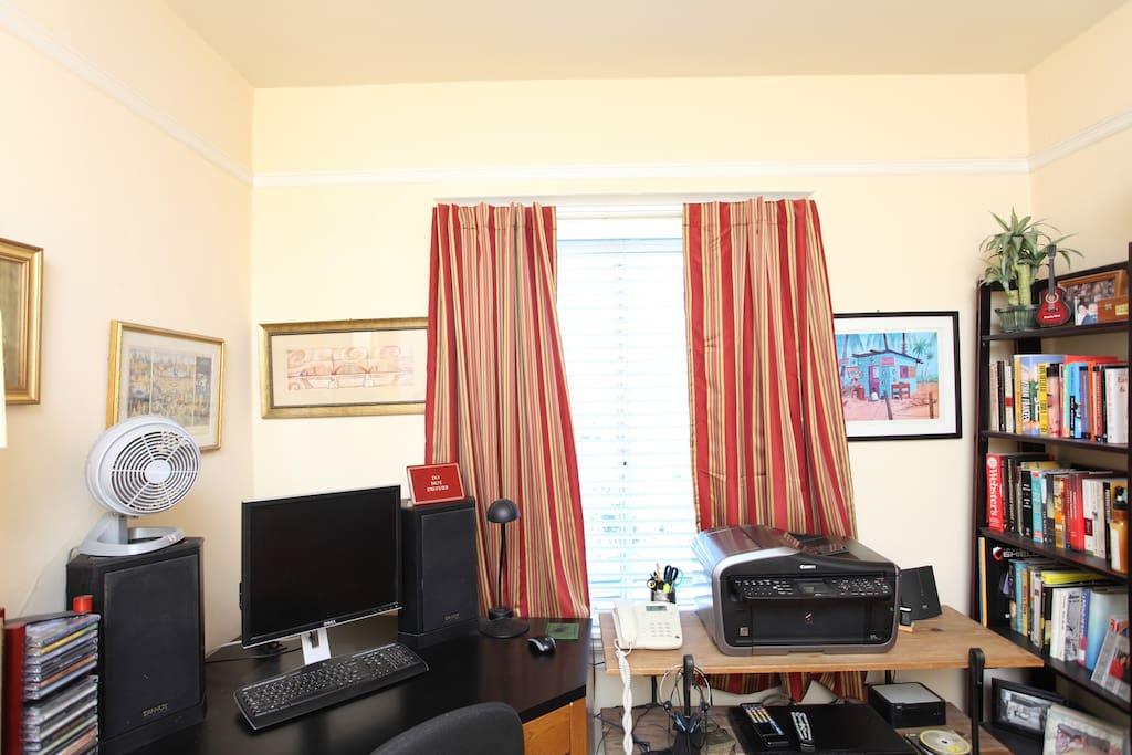 Workspace in bedroom - curtains are darkening & noise dampening.