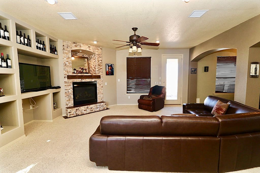 Beautiful spacious living room with rock fireplace.