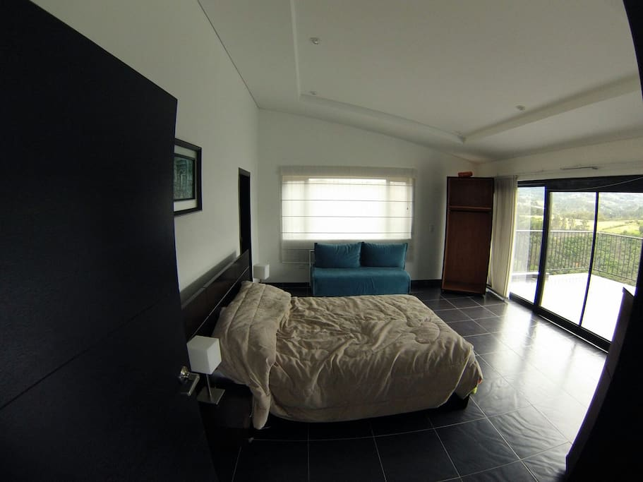 Main room, one queen bed + full sofa cama queen size. Balcon and extra large restroom with cloak room.
