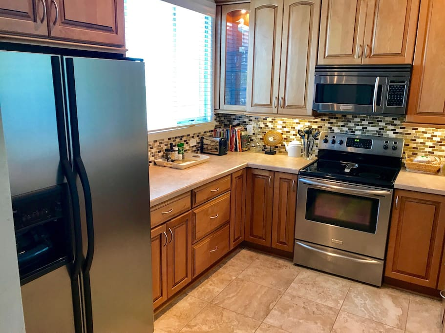 Updated super-stocked kitchen with stainless steel appliances...