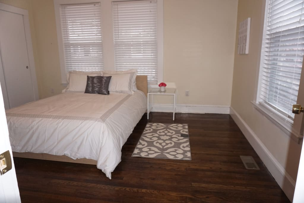 Spacious bedroom with comfortable queen-sized bed
