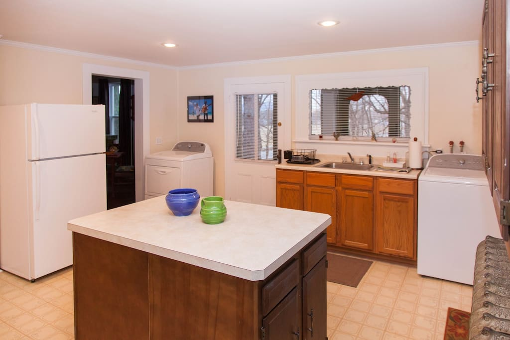 Country kitchen with refrigerator and stove (and washer/dryer)