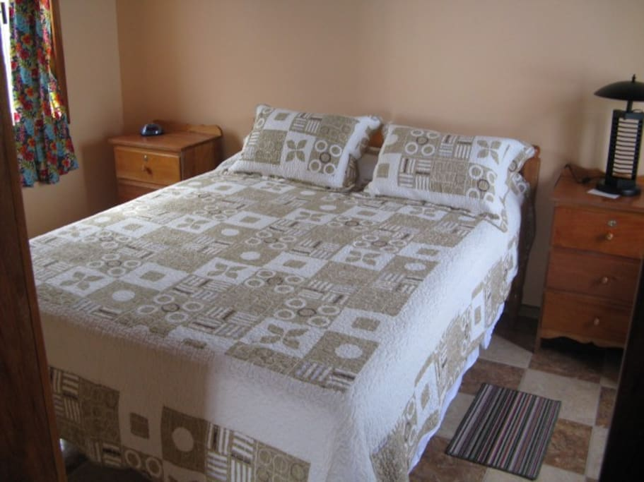 Comfortable Queen size bed in private air conditioned bedroom