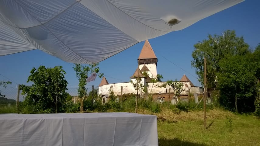 Your place next to a fortified church