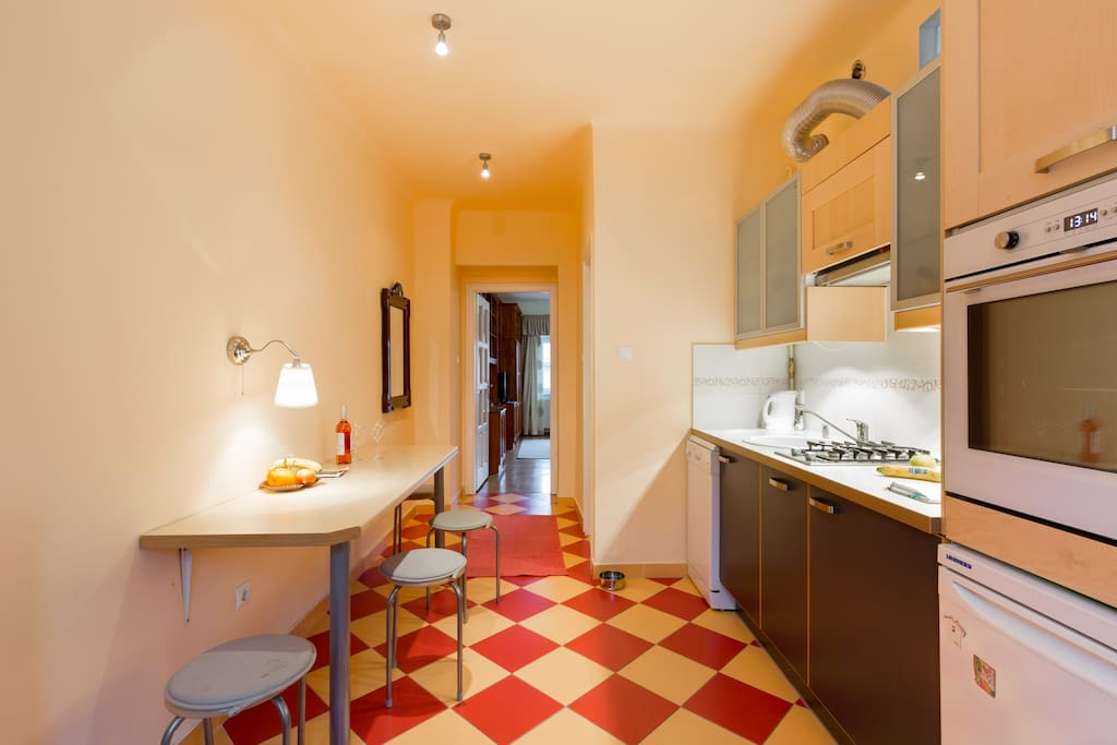 This is what you see when you arrive: the kitchen of the apartment. The bedroom to the right, bathroom straight and right, living room straight ahead :)