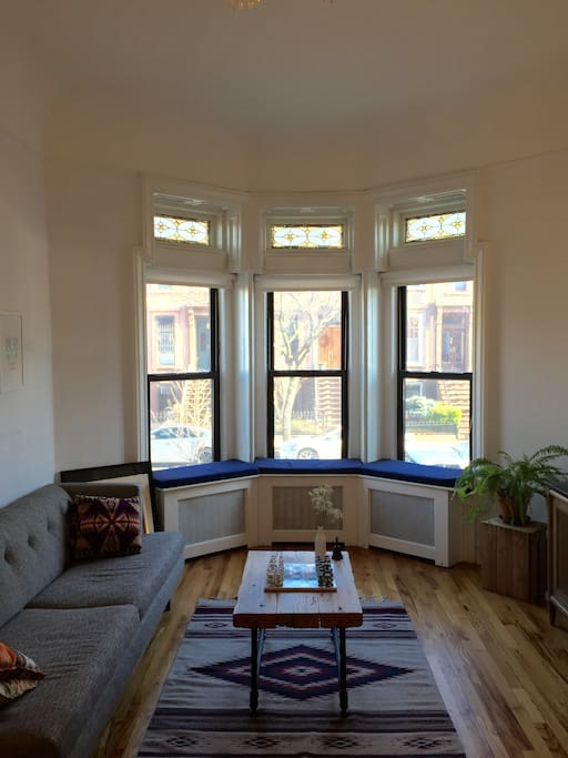Bay windows in front and back of apartment give plenty of natural light