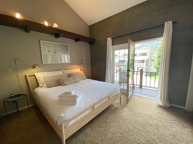 Master bedroom with balcony access.  It has a Master Bathroom attached to the room.