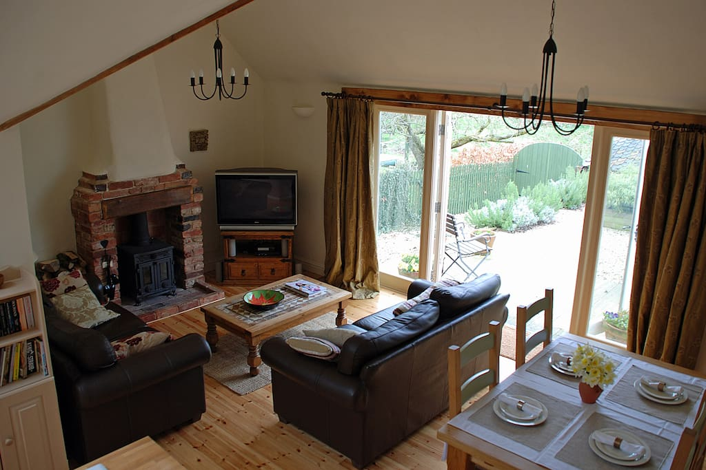 Living-Dining Area with view onto decking and private garden.