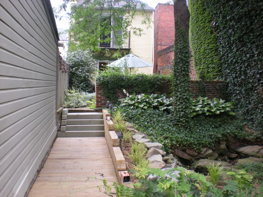 garden and patio /walkway and steps to house. House is privately situated behind garden away from the street.