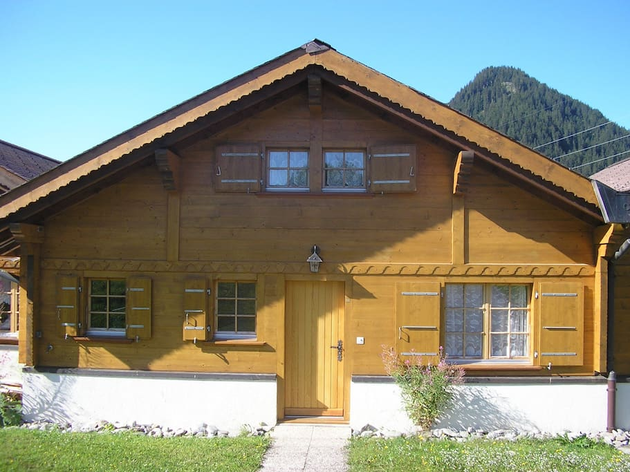 Chalet from front in summer.