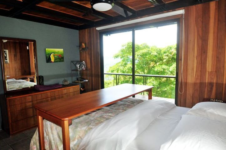 Downstairs bedroom, with queen bed and private access to veranda