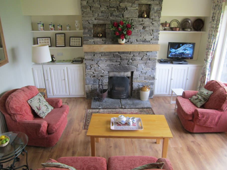 The living room area with open fireplace. Also full central heating radiators throughout the house.