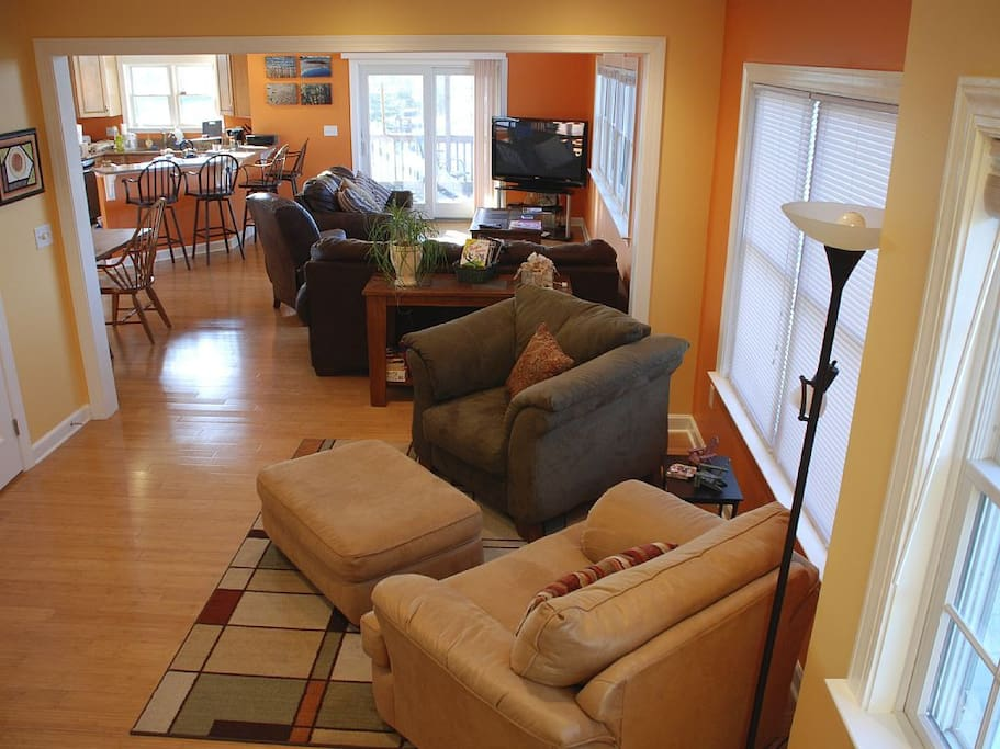 "Plenty of comfy seating shares a ""great room"" space with the kitchen and eating areas blending together."
