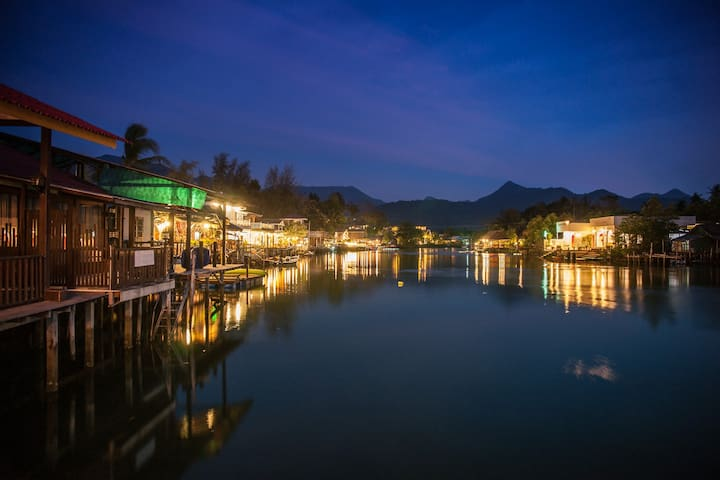 Stunning views from the deck at night: lagoon side restaurants and guest houses