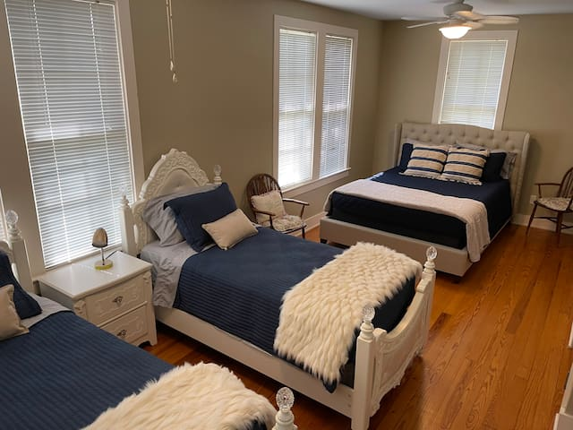 Upstairs bedroom with two twin beds and one queen bed.