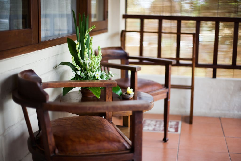 Terrace with coffee table and chairs facing to rice field view