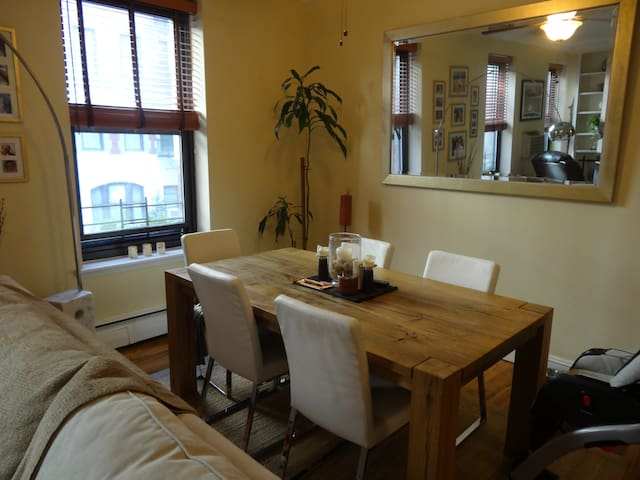 open, bright dining room with 6 leather chairs.