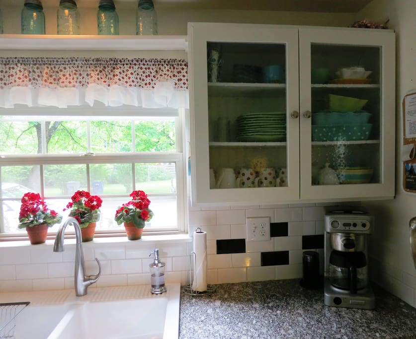 I LOVE this cottage kitchen with coffee grinder, blender, mixer and lots of quality cookware.