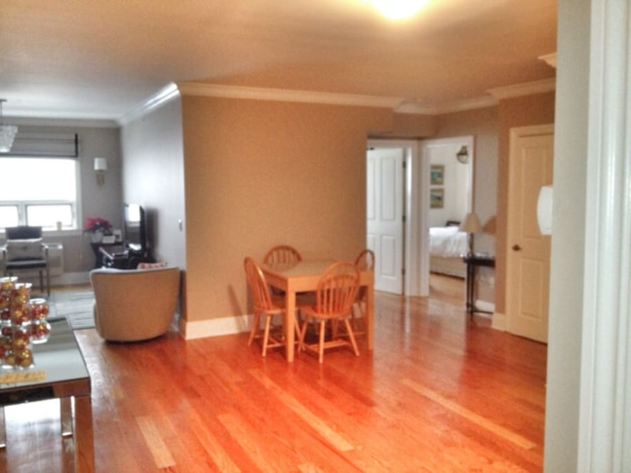 Open dining area/full kitchen (not seen)