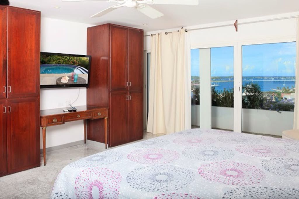 Master Bedroom has wall mounted flat TV with Dual Tuner dish networks satellite feed, and DVD/Blueray player, as well as connectivity to use the TV as a large monitor for your personal laptop via HDMI cable.
