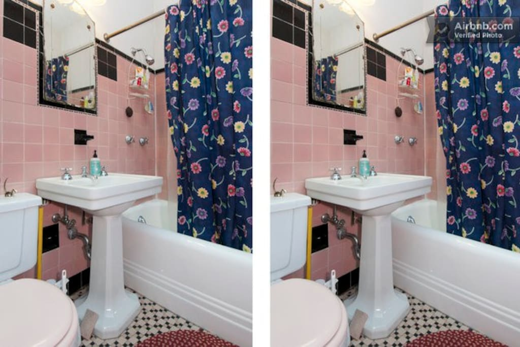 Vintage 1920s bathroom with all modern features. This is a shared bath.