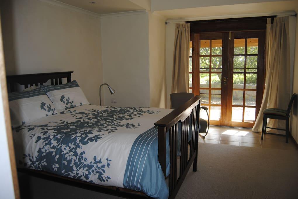 Main bedroom with queen bed, en-suite bathroom, separate toilet and walk in robe