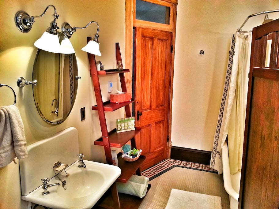 The bathroom is private but not ensuite - access is through the hall, just next door. It was the original bathroom in the house, and it's huge, with a massive clawfoot tub/shower, vintage fixtures, and heated tile floor.