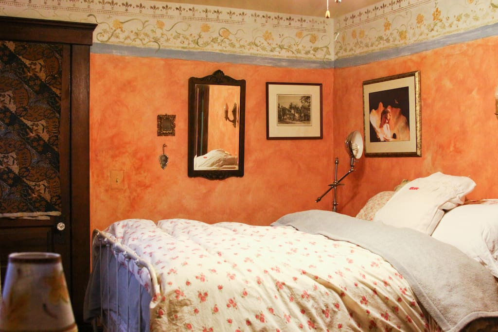 Antique iron double bed in front bedroom (orange walls not as intense as in the photo -- more terracotta)