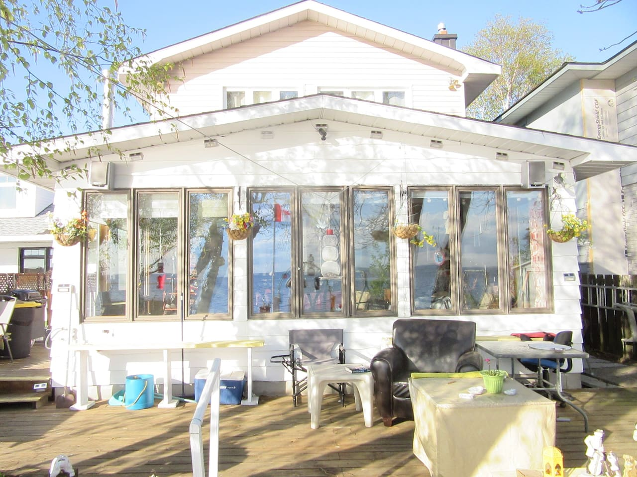 #1 ROOM Queen Bed PLUS  Queen Mattress has  a panoramic view of Lake Nippissing.    Floor-to -ceiling  windows to hear  melodic sounds of gentle waves  and soft   breeze  on  a 30 foot Deck on the white sand where  fish, birds, animals welcome  you.
