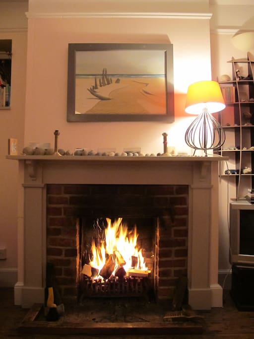 Sitting room - roaring open fire at one end and dining table with marsh view at the other end