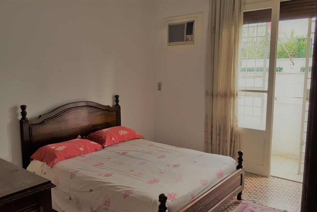 Room 1 with double bed, dressing table and wardrobe