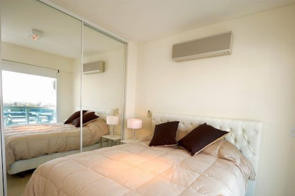 Bedroom with queen size bed and A/C