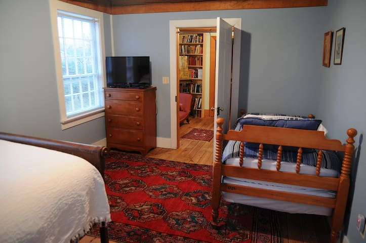 Kids' room with one twin and one full bed and flat-screen HD TV with Roku for streaming.  Room also has closet full of toys and bookcase with children's books