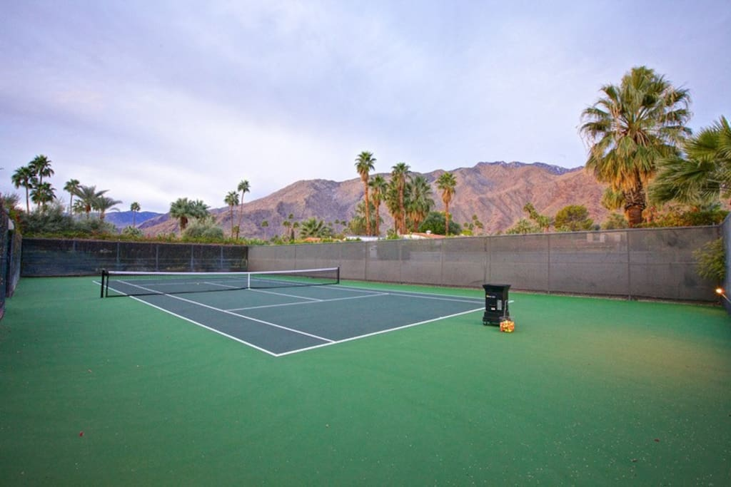 Don't let the pano view ruin your serve...while playing on your private, championship-size tennis court.