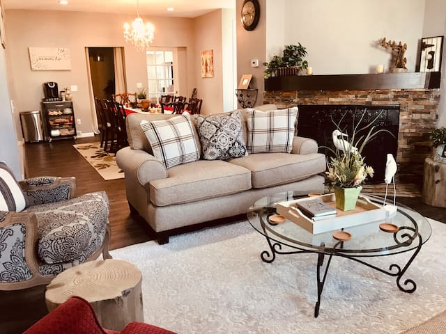 Open living, dining, kitchen. Spacious, cozy, and lovely for hosting or having family over.