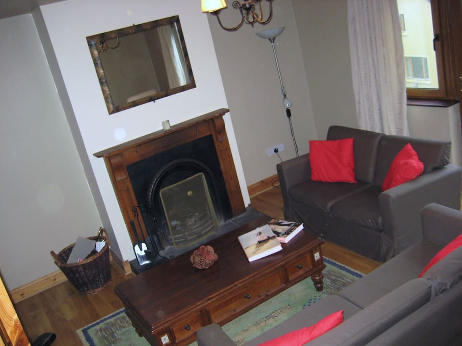 Sitting room with an open fire